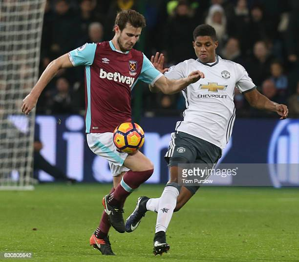 Marcus Rashford of Manchester United in action with Havard Nordtveit of West Ham United during the Premier League match between West Ham United and...