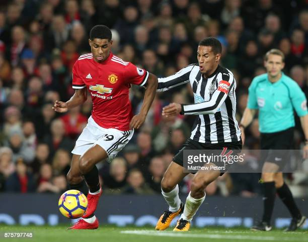 Marcus Rashford of Manchester United in action with Isaac Hayden of Newcastle United during the Premier League match between Manchester United and...