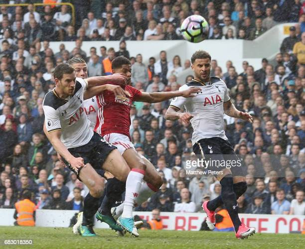 Marcus Rashford of Manchester United in action with Jan Vertonghen and Kyle Walker of Tottenham Hotspur during the Premier League match between...