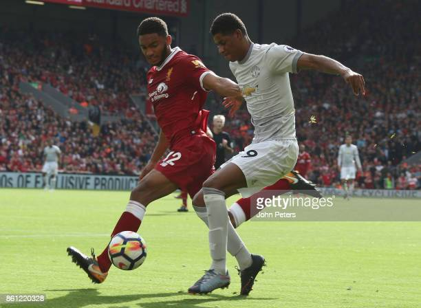 Marcus Rashford of Manchester United in action with Joe Gomez of Liverpool during the Premier League match between Liverpool and Manchester United at...