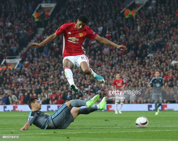 Marcus Rashford of Manchester United in action with Jonny of Celta Vigo during the UEFA Europa League semi final second leg match between Manchester...