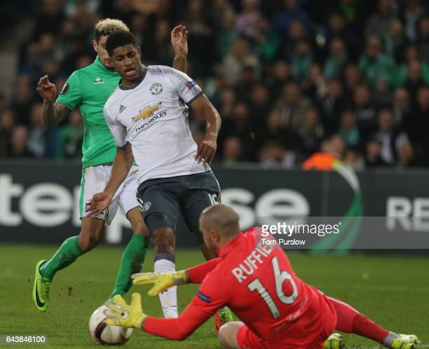 Marcus Rashford of Manchester United in action with Kevin Malcuit and Stephane Ruffier of AS SaintEtienne during the UEFA Europa League Round of 32...