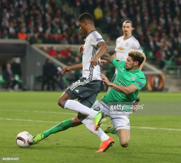 Marcus Rashford of Manchester United in action with Kevin Malcuit of AS SaintEtienne during the UEFA Europa League Round of 32 second leg match...