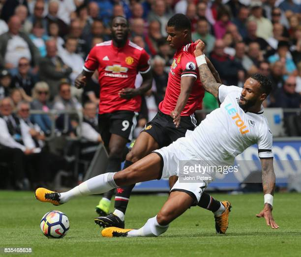 Marcus Rashford of Manchester United in action with Kyle Bartley of Swansea City during the Premier League match between Swansea City and Manchester...