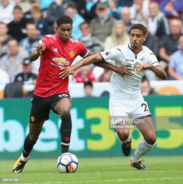 Marcus Rashford of Manchester United in action with Kyle Naughton of Swansea City during the Premier League match between Swansea City and Manchester...