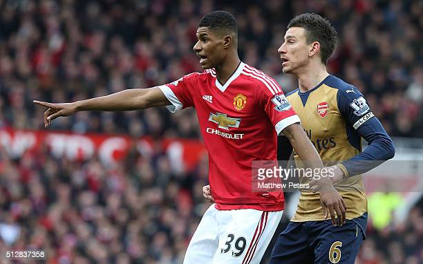 Marcus Rashford of Manchester United in action with Laurent Koscielny of Arsenal during the Barclays Premier League match between Manchester United...