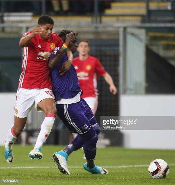 Marcus Rashford of Manchester United in action with Mbodji Kara of ASC Anderlecht during the UEFA Europa League quarter final first leg match between...