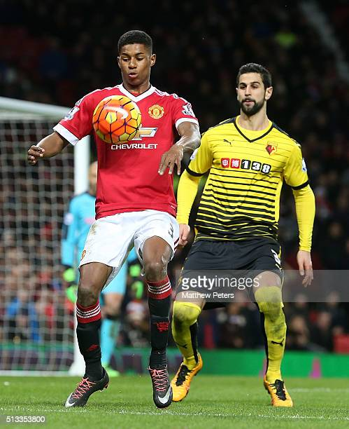 Marcus Rashford of Manchester United in action with Miguel Britos of Watford during the Barclays Premier League match between Manchester United and...