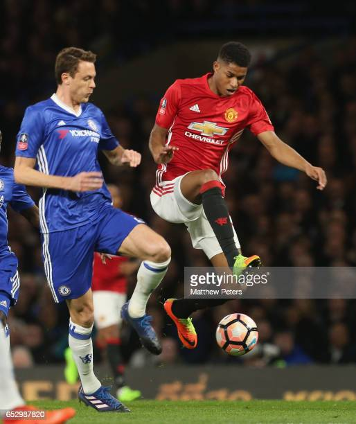 Marcus Rashford of Manchester United in action with Nemanja Matic of Chelsea during the Emirates FA Cup QuarterFinal match between Chelsea and...