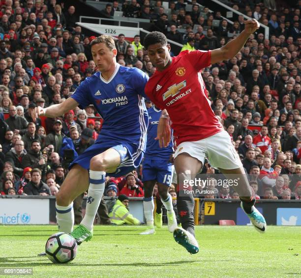 Marcus Rashford of Manchester United in action with Nemanja Matic of Chelsea during the Premier League match between Manchester United and Chelsea at...