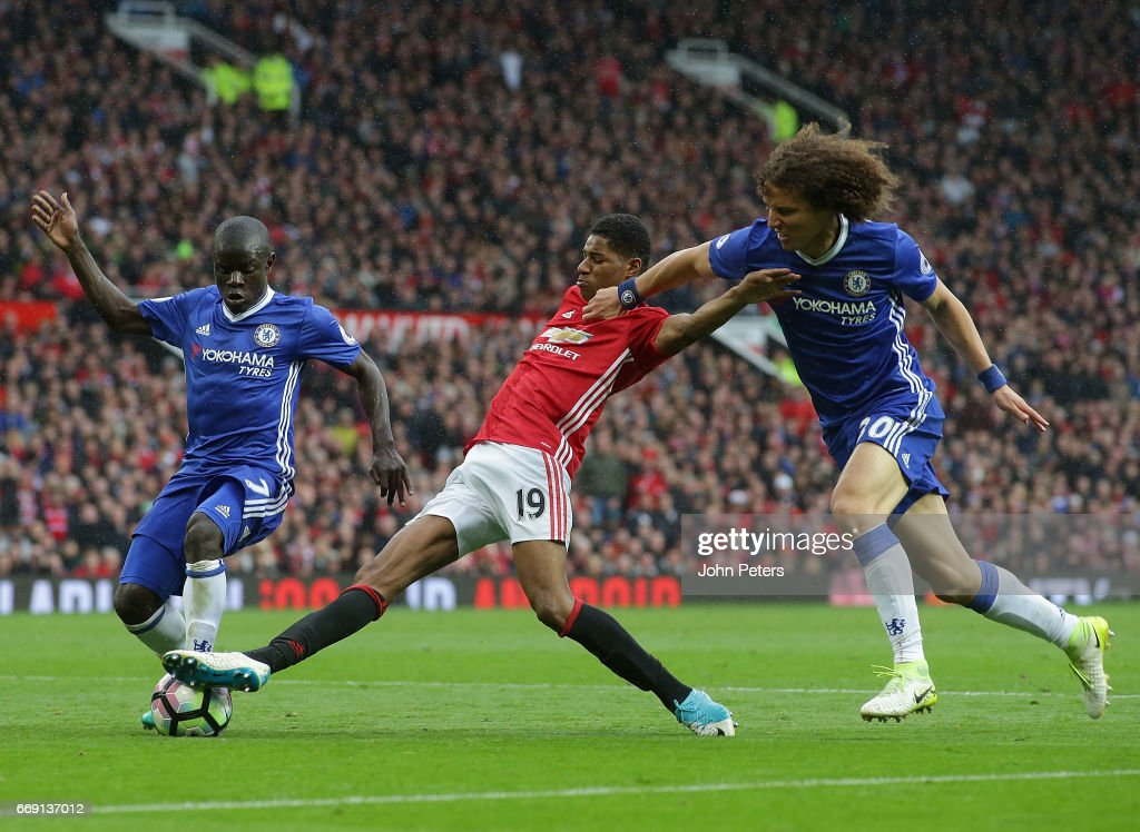 Marcus Rashford of Manchester United in action with Ngolo Kante and David Luiz of Chelsea during the Premier League match between Manchester United and Chelsea at Old Trafford on April 16, 2017 in Manchester, England.