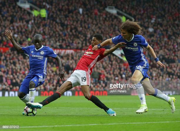 Marcus Rashford of Manchester United in action with Ngolo Kante and David Luiz of Chelsea during the Premier League match between Manchester United...