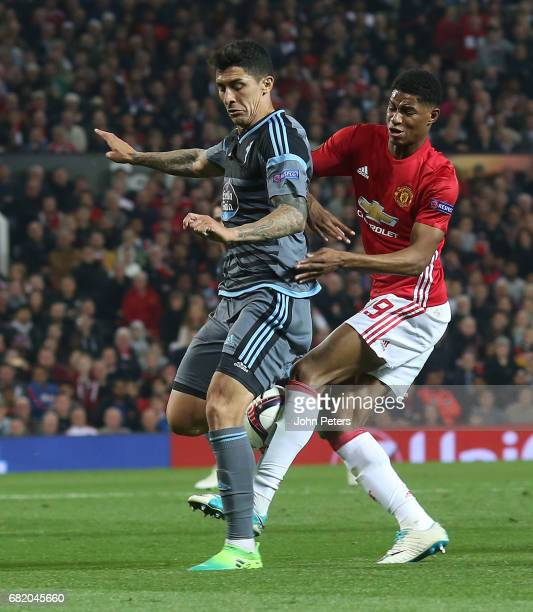 Marcus Rashford of Manchester United in action with Pablo Hernandez of Celta Vigo during the UEFA Europa League semi final second leg match between...