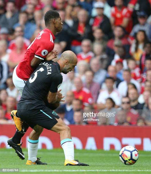 Marcus Rashford of Manchester United in action with Pablo Zabaleta of West Ham United during the Premier League match between Manchester United and...