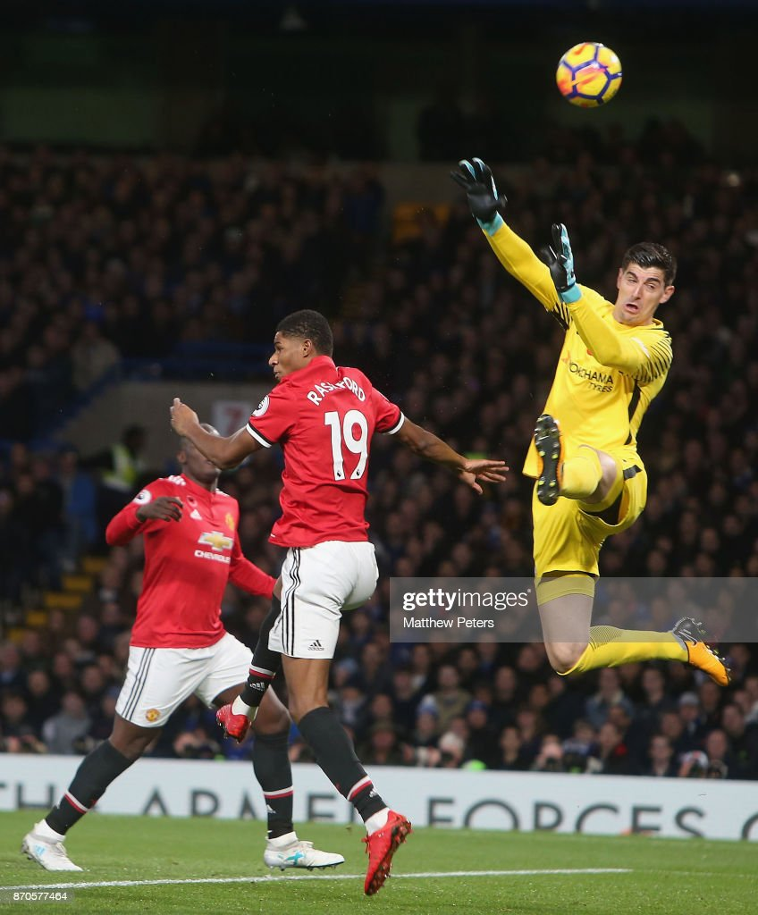 Marcus Rashford of Manchester United in action with Thibaut Courtois of Chelsea during the Premier League match between Chelsea and Manchester United at Stamford Bridge on November 5, 2017 in London, England.