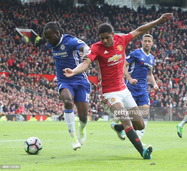 Marcus Rashford of Manchester United in action with Victor Moses of Chelsea during the Premier League match between Manchester United and Chelsea at...