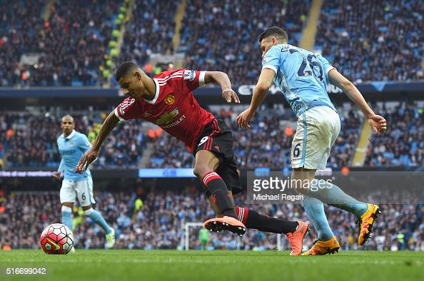 Marcus Rashford of Manchester United is challenged by Martin Demichelis of Manchester City in the penalty area during the Barclays Premier League...