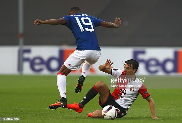 Marcus Rashford of Manchester United is challenged by Steven Berghuis of Feyenoord during the UEFA Europa League Group A match between Feyenoord and...