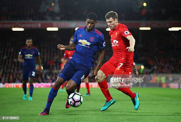 Marcus Rashford of Manchester United is closed down by James Milner of Liverpool during the Premier League match between Liverpool and Manchester...
