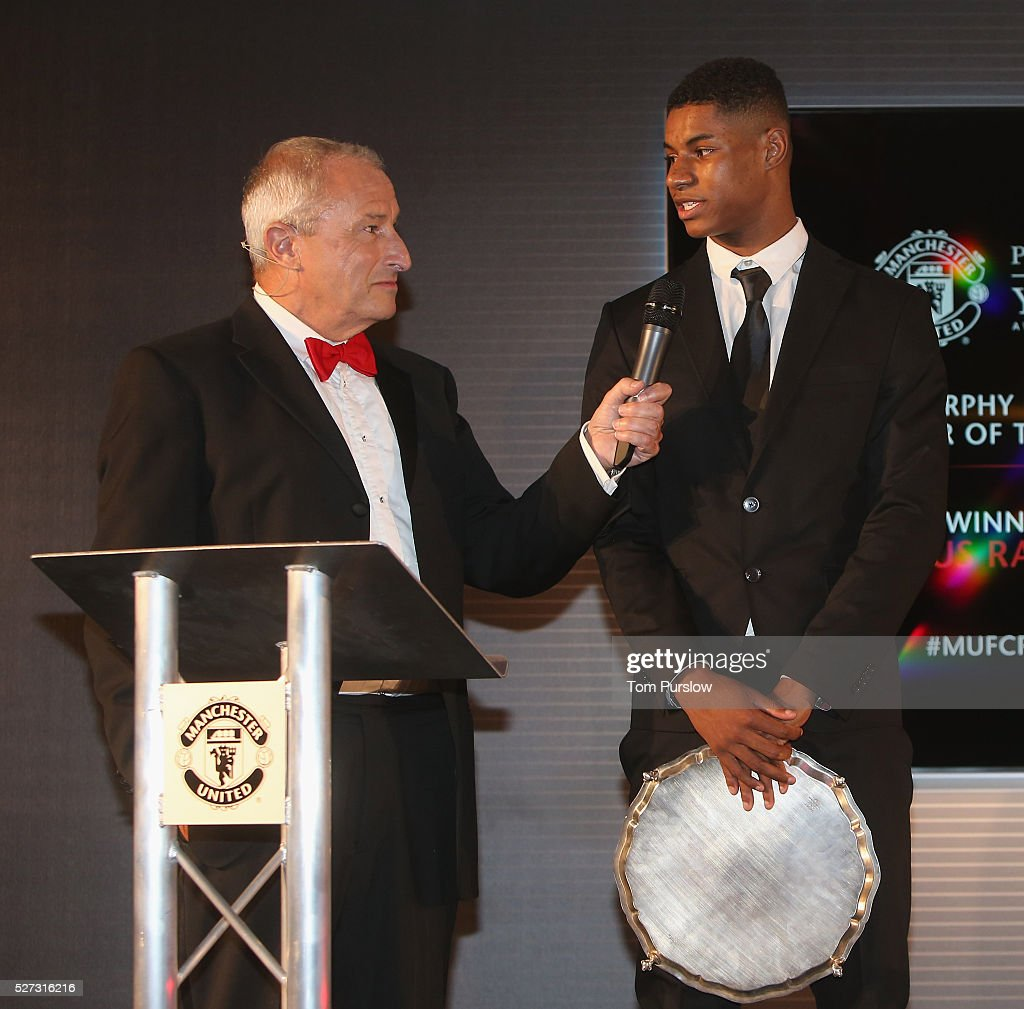 <a gi-track='captionPersonalityLinkClicked' href=/galleries/search?phrase=Marcus+Rashford&family=editorial&specificpeople=13847707 ng-click='$event.stopPropagation()'>Marcus Rashford</a> of Manchester United is interviewed by host <a gi-track='captionPersonalityLinkClicked' href=/galleries/search?phrase=Jim+Rosenthal&family=editorial&specificpeople=1707616 ng-click='$event.stopPropagation()'>Jim Rosenthal</a> at the club's annual Player of the Year awards at Old Trafford on May 2, 2016 in Manchester, England.