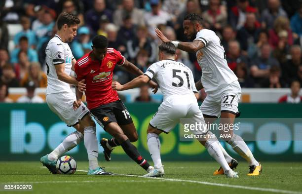 Marcus Rashford of Manchester United is marked during the Premier League match between Swansea City and Manchester United at Liberty Stadium on...