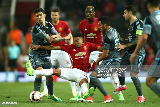 Marcus Rashford of Manchester United is surrounded by the Celta Vigo players during the UEFA Europa League semi final second leg match between...