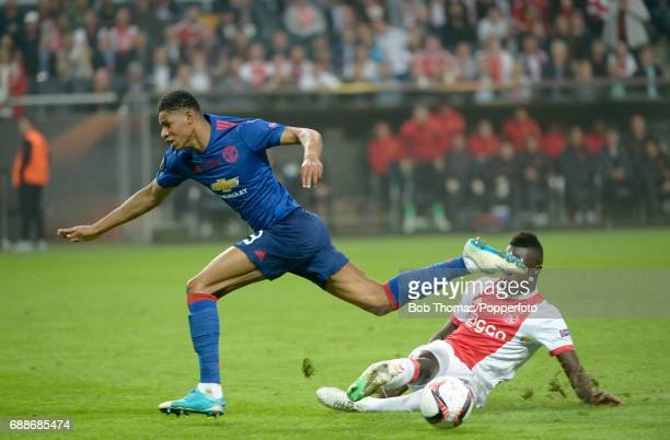 Marcus Rashford of Manchester United is tackled by Davinson Sanchez of Ajax during the UEFA Europa League final between Ajax and Manchester United at...