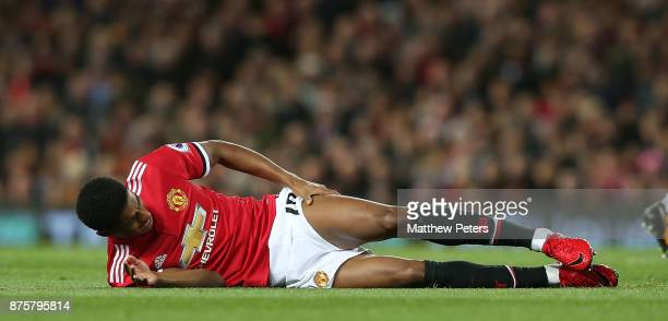 Marcus Rashford of Manchester United lies injured during the Premier League match between Manchester United and Newcastle United at Old Trafford on...