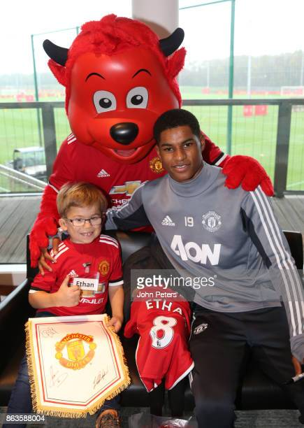 Marcus Rashford of Manchester United poses with Ethan 8 during a MU Foundation Dream Day at Aon Training Complex on October 20 2017 in Manchester...