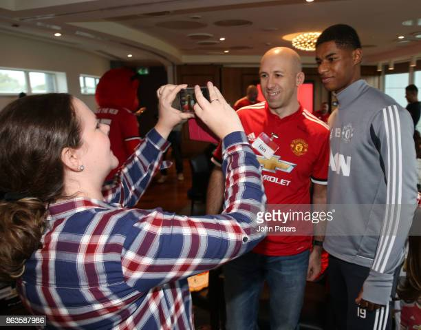 Marcus Rashford of Manchester United poses with Ian during a MU Foundation Dream Day at Aon Training Complex on October 20 2017 in Manchester England