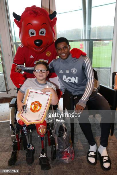 Marcus Rashford of Manchester United poses with Robbie during a MU Foundation Dream Day at Aon Training Complex on October 20 2017 in Manchester...