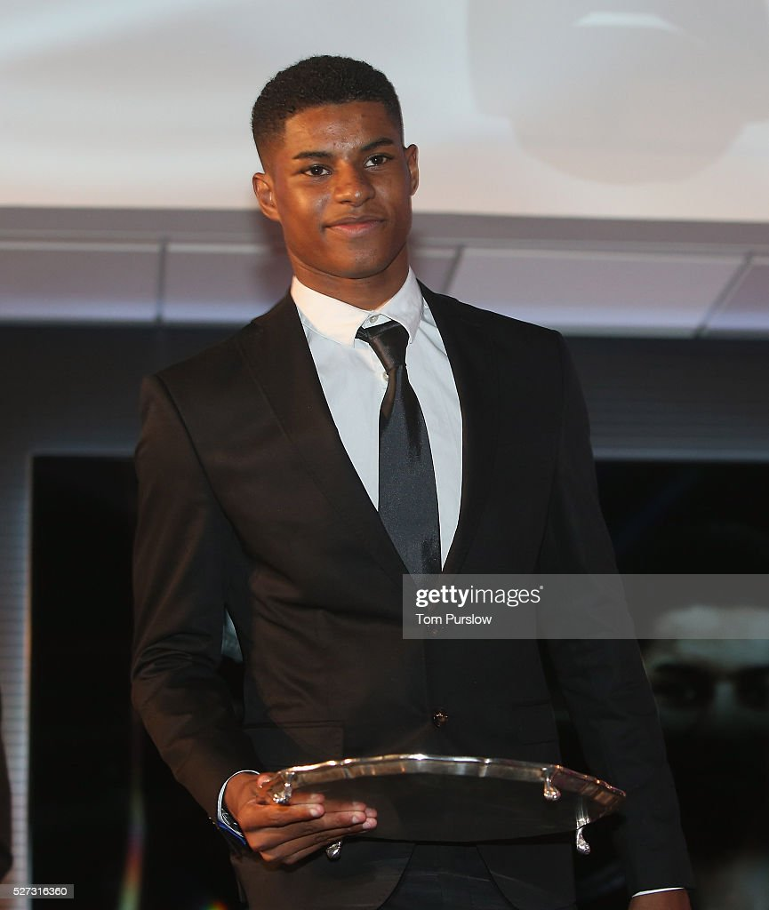 Marcus Rashford of Manchester United poses with the Jimmy Murphy Young Player of the Season award at the club's annual Player of the Year awards at Old Trafford on May 2, 2016 in Manchester, England.