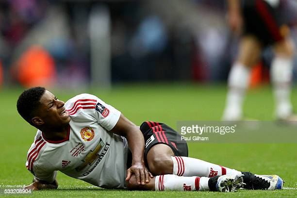 Marcus Rashford of Manchester United reacts as he lies on the pitch after picking up an injury during The Emirates FA Cup Final match between...