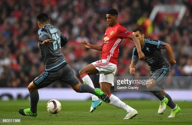 Marcus Rashford of Manchester United runs at Facundo Roncaglia of Celta Vigo during the UEFA Europa League semi final second leg match between...