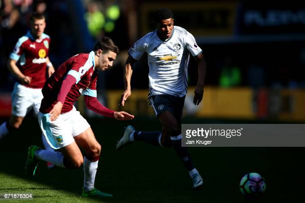 Marcus Rashford of Manchester United runs with the ball under pressure from Matthew Lowton of Burnley during the Premier League match between Burnley...