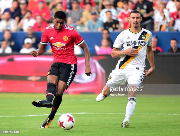 Marcus Rashford of Manchester United scores as Daniel Steres of Los Angeles Galaxy looks on during the first half at StubHub Center on July 15 2017...