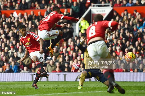 Marcus Rashford of Manchester United scores his opening goal during the Barclays Premier League match between Manchester United and Arsenal at Old...