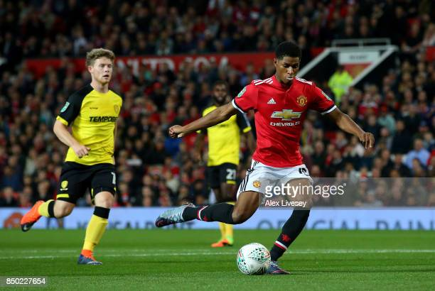 Marcus Rashford of Manchester United scores his sides first goal during the Carabao Cup Third Round match between Manchester United and Burton Albion...