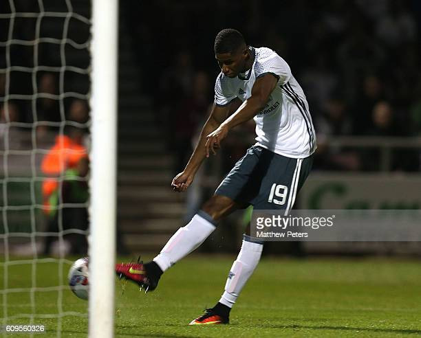 Marcus Rashford of Manchester United scores his team's third goal during the EFL Cup Third Round match between Northampton Town and Manchester United...