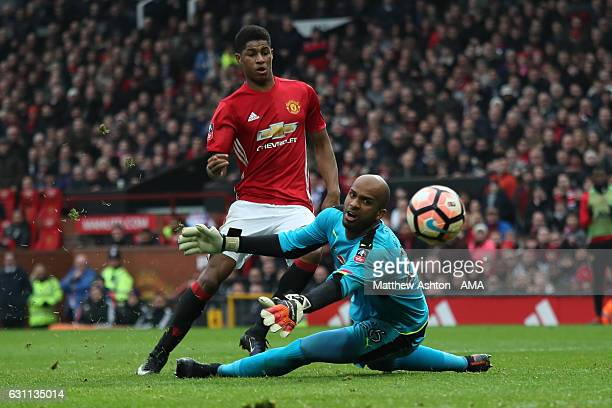 Marcus Rashford of Manchester United scores his team's third goal to make the score 30 past Ali Al Habsi of Reading during the Emirates FA Cup third...