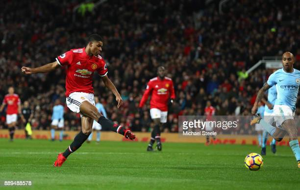 Marcus Rashford of Manchester United scores the 1st Manchester United goal during the Premier League match between Manchester United and Manchester...