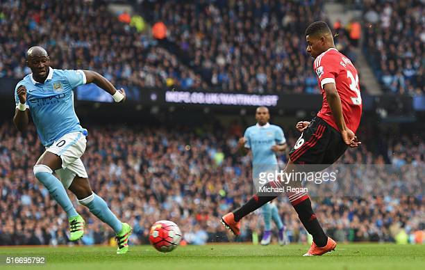 Marcus Rashford of Manchester United scores their first goal during the Barclays Premier League match between Manchester City and Manchester United...