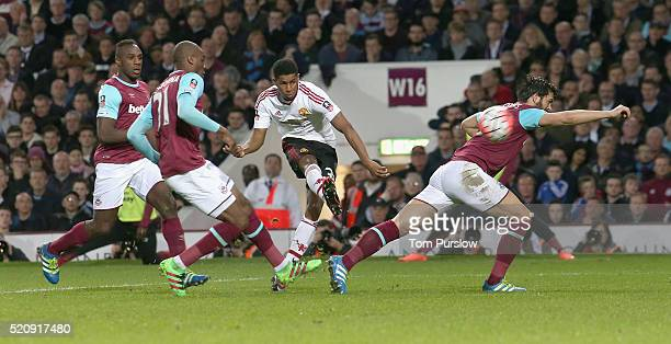 Marcus Rashford of Manchester United scores their first goal during the Emirates FA Cup Sixth Round replay match between West Ham United and...