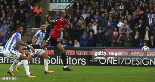 Marcus Rashford of Manchester United scores their first goal during the Premier League match between Huddersfield Town and Manchester United at John...