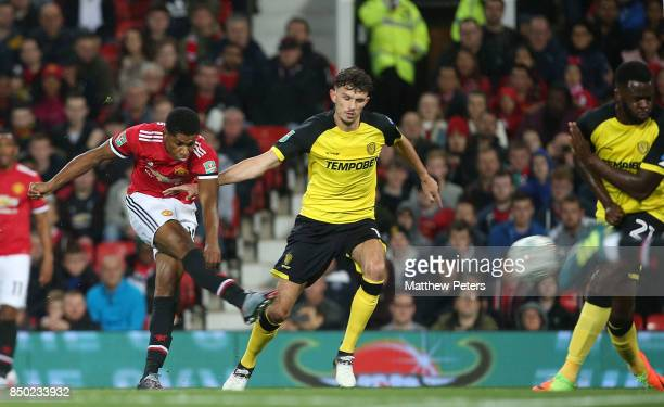 Marcus Rashford of Manchester United scores their second goal during the Carabao Cup Third Round between Manchester United and Burton Albion at Old...