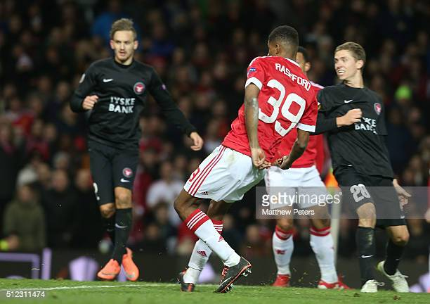 Marcus Rashford of Manchester United scores their third goal during the UEFA Europa League match between Manchester United and FC Midtjylland at Old...
