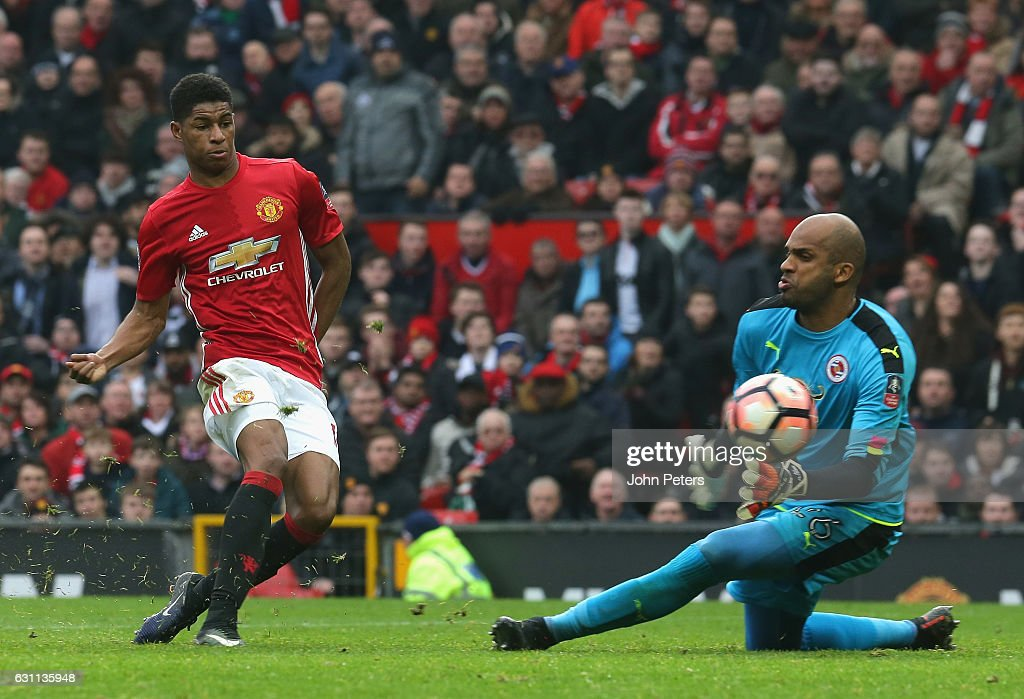 Marcus Rashford of Manchester United scores their third goal during the Emirates FA Cup Third Round match between Manchester United and Reading at Old Trafford on January 7, 2017 in Manchester, England.