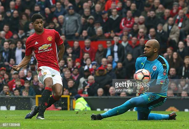 Marcus Rashford of Manchester United scores their third goal during the Emirates FA Cup Third Round match between Manchester United and Reading at...