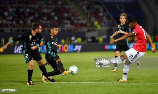 Marcus Rashford of Manchester United shoots as Casemiro of Real Madrid and Daniel Carvajal of Real Madrid attempt to block during the UEFA Super Cup...