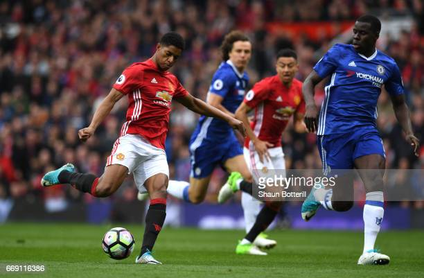 Marcus Rashford of Manchester United shoots during the Premier League match between Manchester United and Chelsea at Old Trafford on April 16 2017 in...